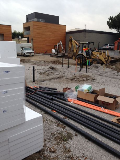 Stacks of foam await installation under concrete foundation for insulation